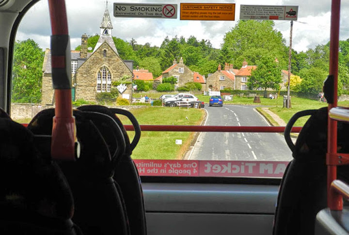 The view from the top deck of a bus as it approaches Hutton Le Hole