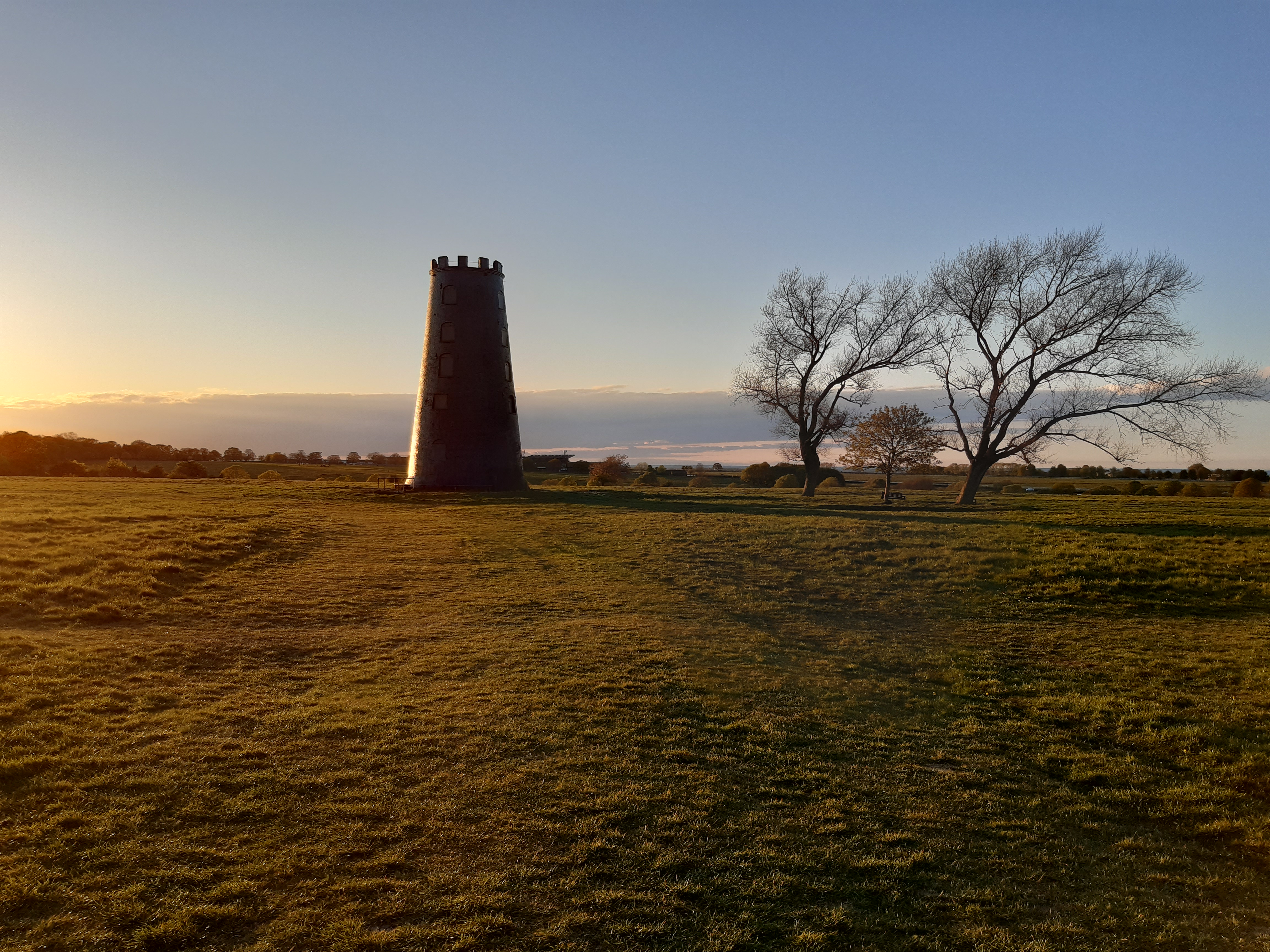 The green pastures of Beverley Westwood with Black Mill, an old windmill without sails