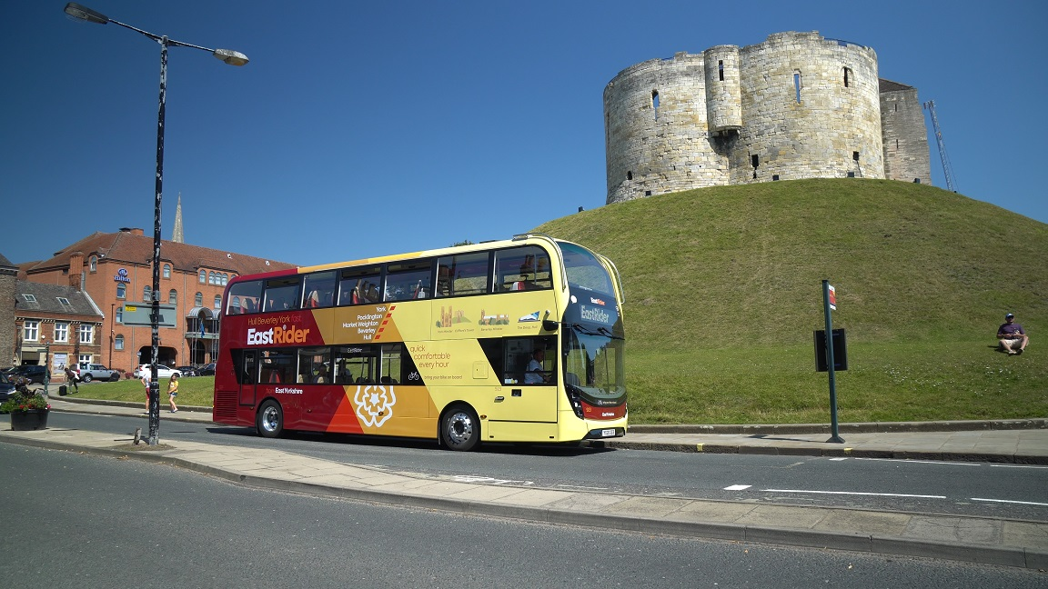 An East Yorkshire bus in front of Clifford's Tower in York